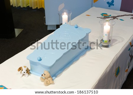 A blue coffin for a little boy in a morgue