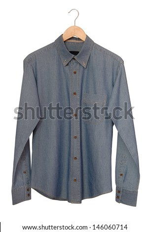 A blue denim shirt is on clothes-hanger.  - stock photo