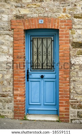 A blue door in a stone wall
