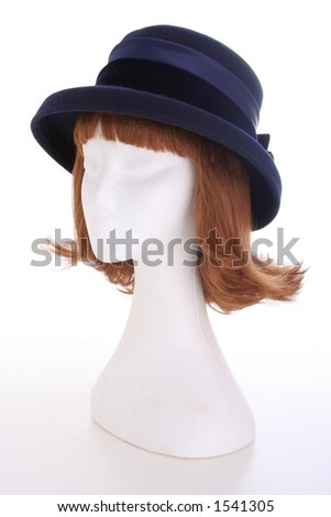 A blue ladies hat on a white manequin isolated on white
