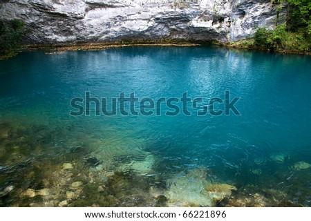 a blue lake in mountains, abkhazia - stock photo