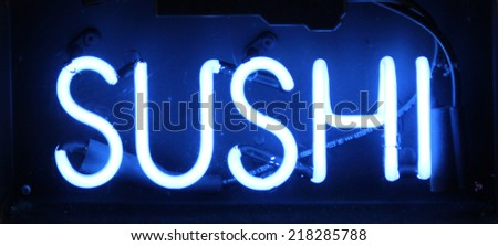 A blue neon sign that reads Sushi