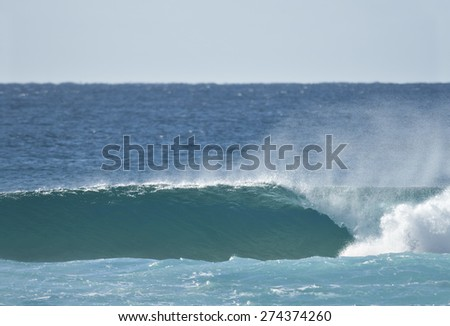 A blue ocean wave. - stock photo
