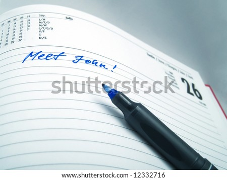 A blue pen on a calendar
