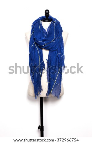 A blue scarf with mannequin isolated white. - stock photo