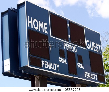 A blue scoreboard in the outfield of a baseball field - stock photo