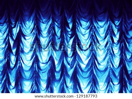 a blue shining curtain on the wall