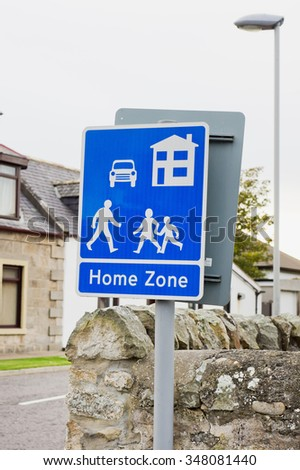 A blue sign for a residential area in Lossiemouth, Scotland