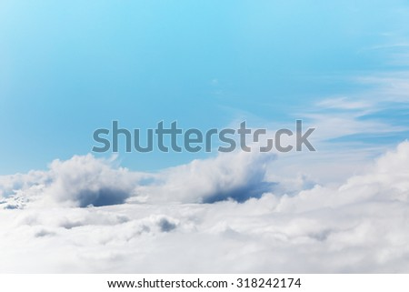 A blue sky cloudscape background with beautiful white clouds shoted from airplane - stock photo