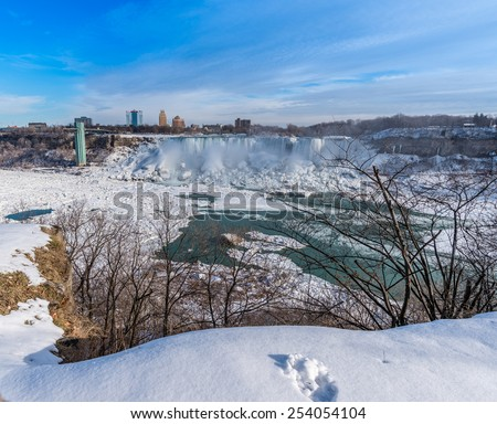 A blue sky day at the frozen Niagara Falls. - stock photo