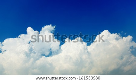 A blue sky with big white clouds. - stock photo