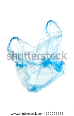 A blue transparent plastic bag floating - stock photo