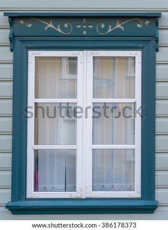 A blue window with white trim on a house in Reykjavik Iceland