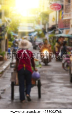 A blurred background of a street scene in Thailand, Asia. - stock photo