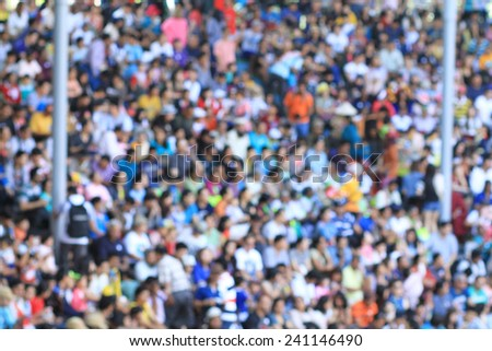 A blurred crowd in a stadium  - stock photo