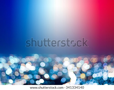 A blurred-out city night scene overlaid by transparent blue white and red colors in the background as a symbol of France or Paris - stock photo