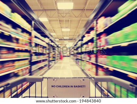 a blurred shot of an isle in a supermarket or grocery store shop done with a retro vintage instagram filter  - stock photo