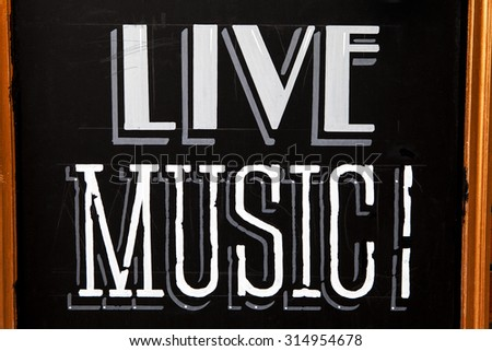 A board advertising Live Music! - stock photo