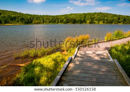 A boardwalk trail encircling Spruce Knob Lake, in Monongahela National Forest, West Virginia. - stock photo