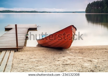 A boat and a pier in Finland - stock photo