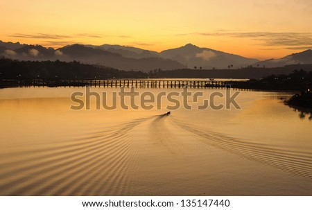 A boat and water flow line in the morning, Thailand