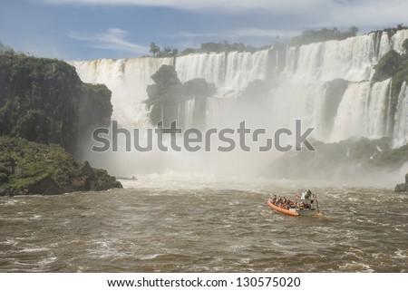 A boat approaching to Iguassu falls (Iguazu/Iguacu), Misiones, Argentina. - stock photo