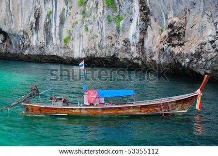 a boat at Koh Mook cliff, Trang, Thailand - stock photo