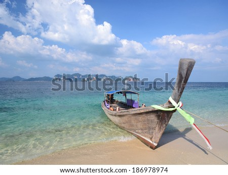 A boat at the beach shore