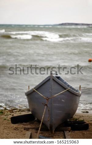 A boat at the seashore on a cloudy day