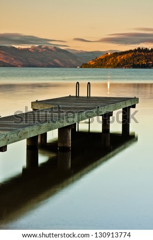 A boat Dock at Sunrise on a Mountain Lake