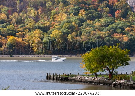 A boat going north on the Hudson River in Cold Spring, NY.