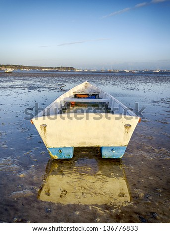 A boat moored at Sandbanks in Poole Harbour in Dorset