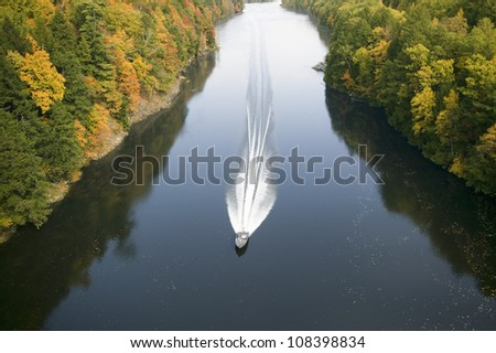 A boat navigates the Connecticut River on the Mohawk Trail of western Massachusetts, New England - stock photo