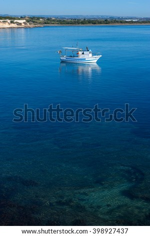 a boat on the blue sea of Sicily, Italy, Europe