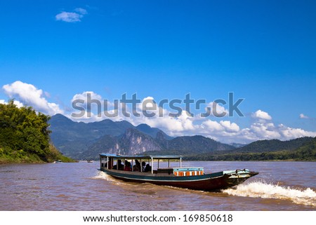 A boat ride on the Mekong River in Laos - stock photo