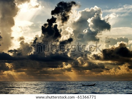 A boat with a dramatic cloud