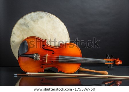 A Bodhran and Viola on a black background - stock photo