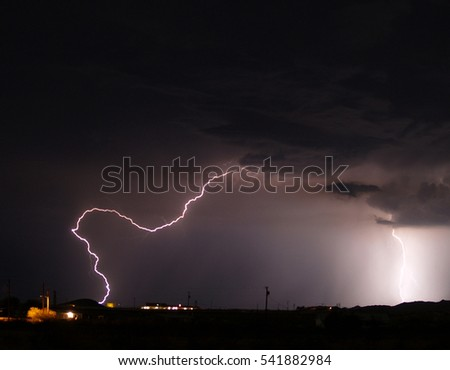 A bolt of lightning arcing through the night sky during the 2006 Arizona Monsoon.