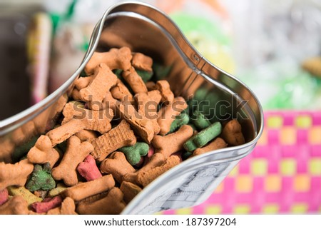 A bone shaped tin of dog treats on offer at a pet store - stock photo