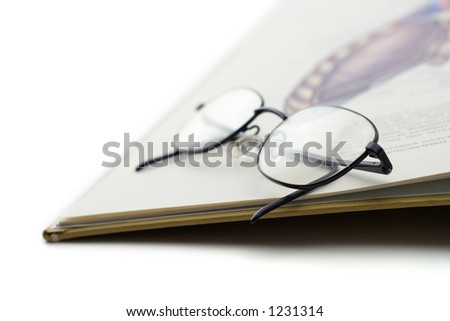 A book and a pair of glasses