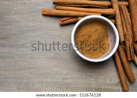 A border made with stick and ground cinnamon with copy space. - stock photo