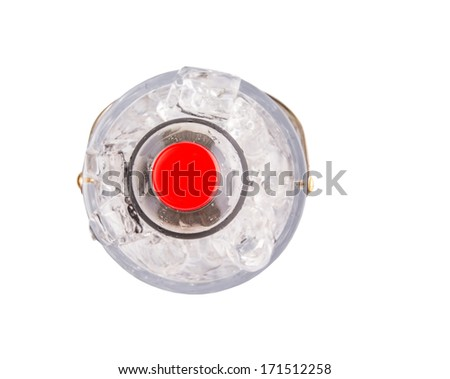 A bottle of cola drink cooled with ice cubes - stock photo
