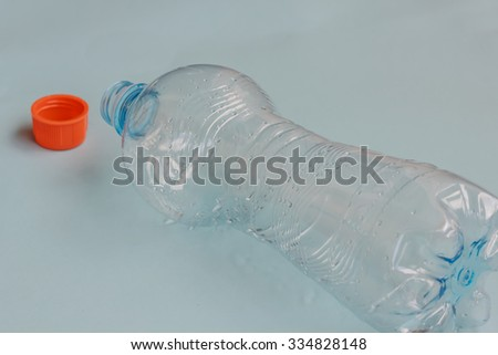 a bottle of fresh water emptied and abandoned - stock photo