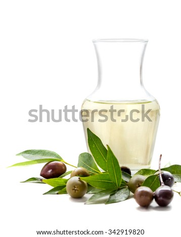 a bottle of olive oil with green olives and black olives isolated on white background - stock photo