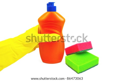 A bottle of orange with a detergent, hand in glove yellow, two sponges of green and red colors isolated on white background - stock photo