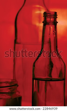 A bottle of red-colored still life