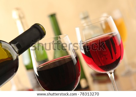 A bottle of red wine and two glasses - stock photo