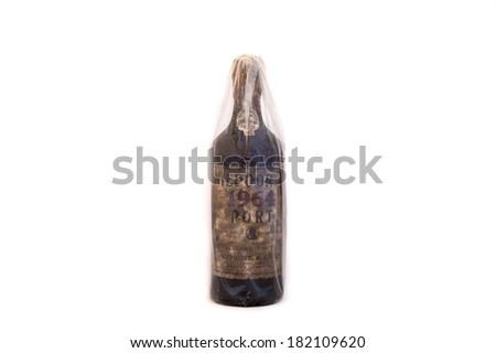 A bottle of Vintage Porto (port) wine from 1964. Illustrative editorial, the photo is taken on March 15, 2014 in Porto, Portugal. Porto is produced exclusively from the Northern regions of Portugal. - stock photo