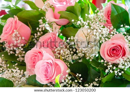 a bouquet - a white rose among pink ones - stock photo
