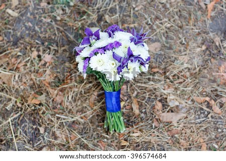 A bouquet of blue irises and white chrysanthemums. - stock photo